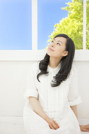 Women sit on the windowsill Stock Photo