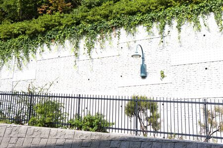 circumference: Fences and white wall of the sidewalk of Ebisu
