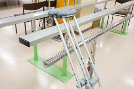 crutches: Crutches placed on parallel bars