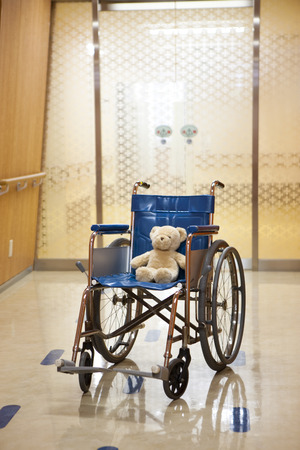 medical treatment: Teddy bear that has been placed in the wheelchair
