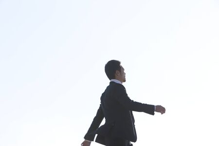 ambivalence: Businessman walking