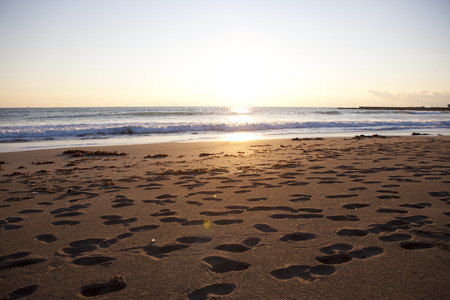 borrowed: Footprints of sandy beach that is illuminated in Chaoyang Stock Photo
