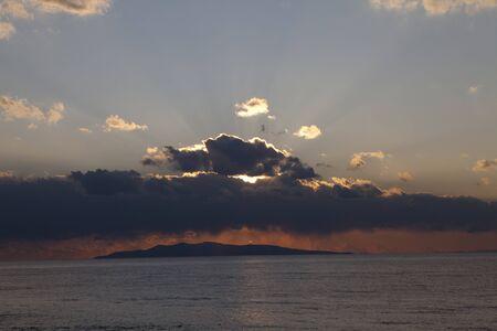 setting  sun: Setting sun hidden by clouds Stock Photo