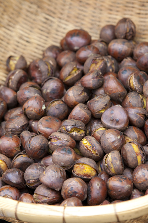 stalls: Roasted chestnut stalls selling Stock Photo