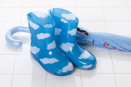 necessities: Childrens rain boots and umbrella Stock Photo