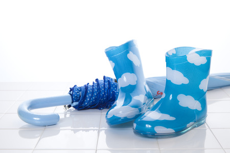 Childrens rain boots and umbrella Stock Photo