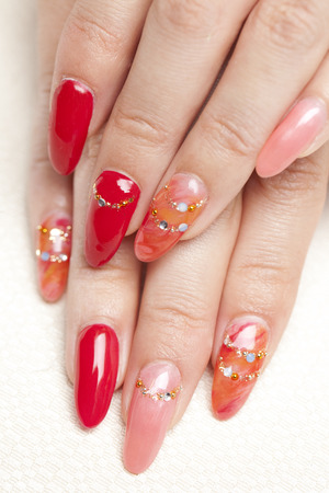 nailcare: hand of a woman nail care has ended