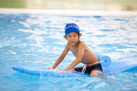 Elementary school students playing by the pool boy photo