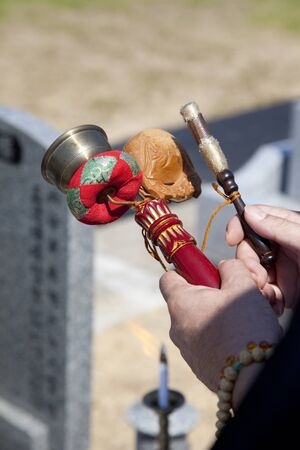 scriptures: Buddhist memorial service scene at cemetery Stock Photo