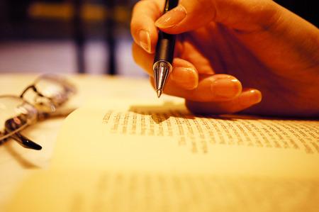 Hand writing translation in close-up shot