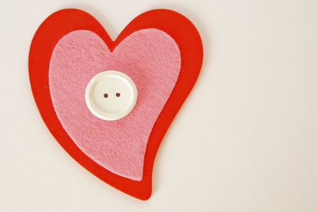 Heart shaped quilting with button Stok Fotoğraf