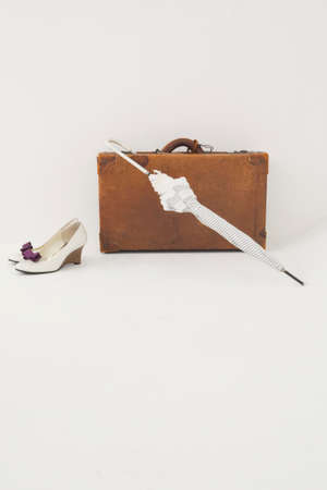 parasol: Trunks and shoes and parasol Stock Photo