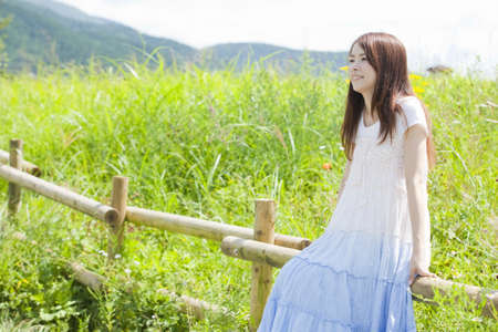 asian natural: Fence and women of the tree Stock Photo