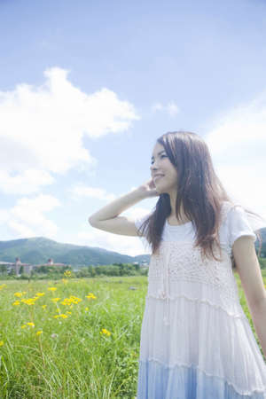 asian natural: Meadow and women Stock Photo