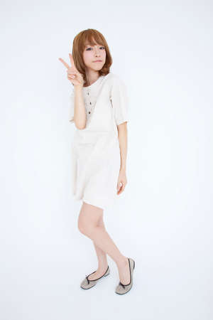 one piece dress: A woman pose for peace