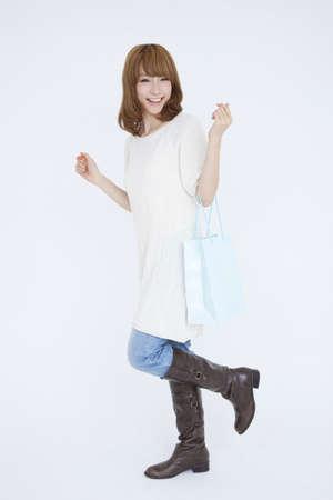 splurge: Woman with shopping bag