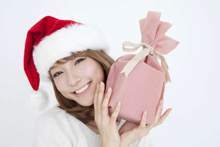 livelihood: Woman wearing a Santa Hat