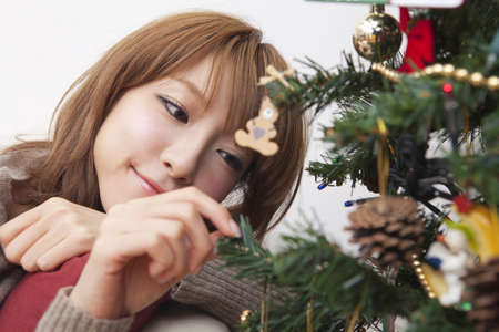 Woman with Christmas tree photo