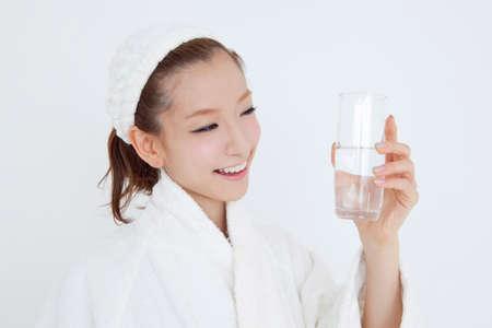 oriental bathrobe: Woman drinking water Stock Photo