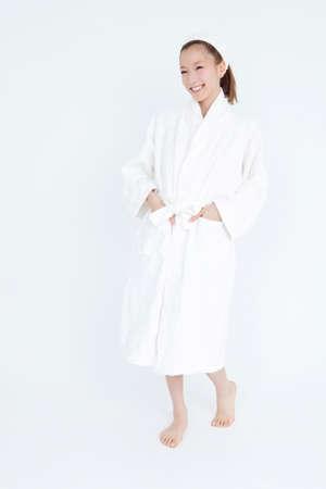 woman bathrobe: Woman wearing a bathrobe