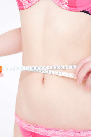 woman measuring waist: Woman measuring waist size