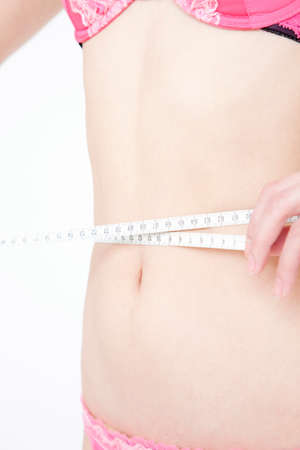 Woman measuring waist size photo