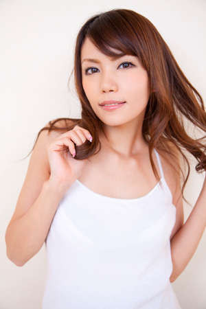 camisole: Woman wearing a white Camisole Stock Photo