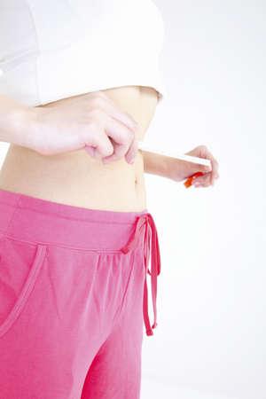woman measuring waist: Hungry woman measuring waist size Stock Photo