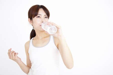 water bottles: Women drinking water