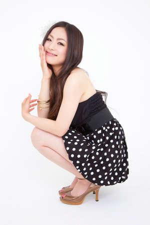 girl squatting: Smiling woman Stock Photo