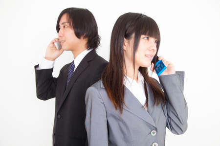 new recruit: Men and women who have a cell phone Stock Photo