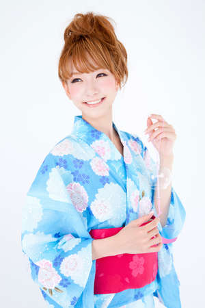 get dressed: Women dressed in yukata have wind chimes
