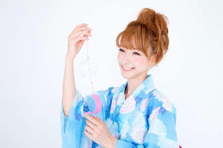 get dressed: Women dressed in yukata have wind chimes
