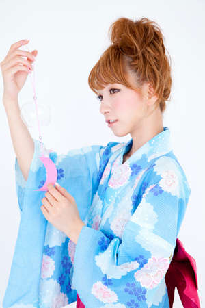 wind chime: Women dressed in yukata have wind chimes