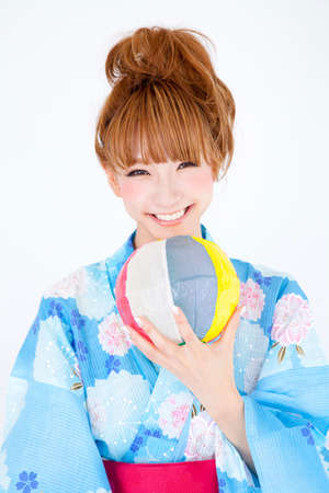 get dressed: Women dressed in yukata are playing with paper balloons