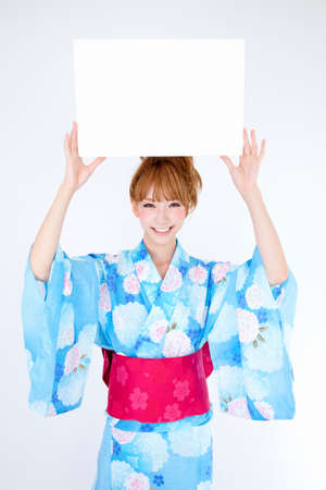message board: Women dressed in yukata have message board Stock Photo