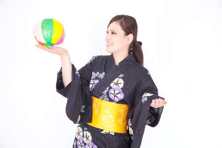 get dressed: Women yukata playing with paper balloons