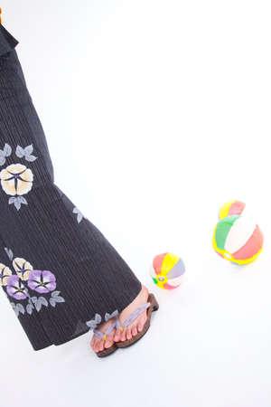 get dressed: Feet of women yukata playing in the paper balloon