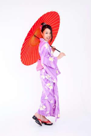 get dressed: Yukata have umbrellas for women Stock Photo
