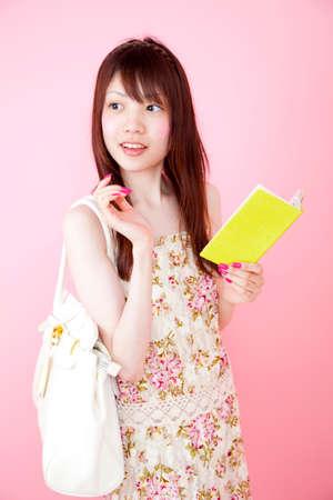 handbook: College girls have a handbook Stock Photo