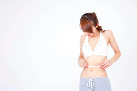 measuring waist: Woman measuring waist size