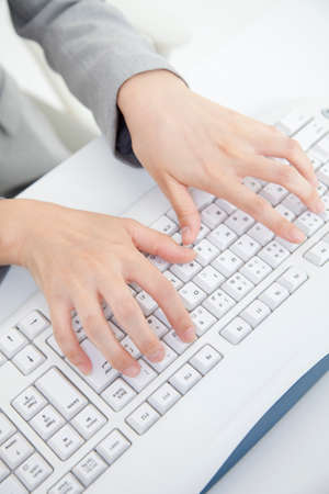 personal computer: Hand of OL who is operating the personal computer
