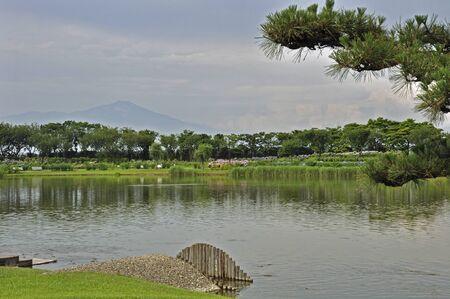 early summer: Early summer of Sakata-swan pond and Mt.Chokai