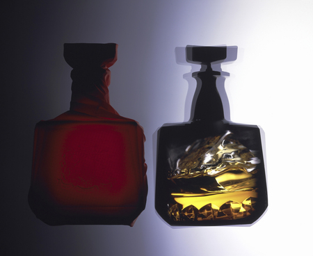sizzle: Sizzle of rock glass that was mirrored in the whiskey bottle