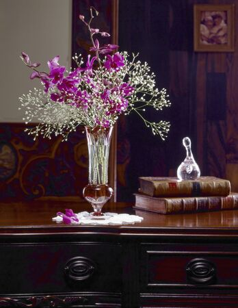 antique furniture: Vase that was alive orchids placed in the antique furniture