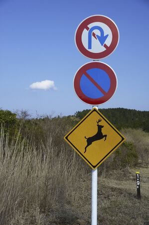animal only: Road signs of deer jumped attention