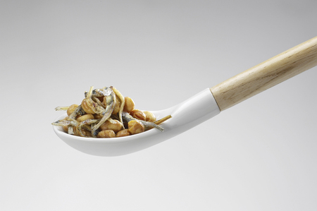 whitebait: Of snacks that were served in a ceramic spoon whitebait and soybean Stock Photo