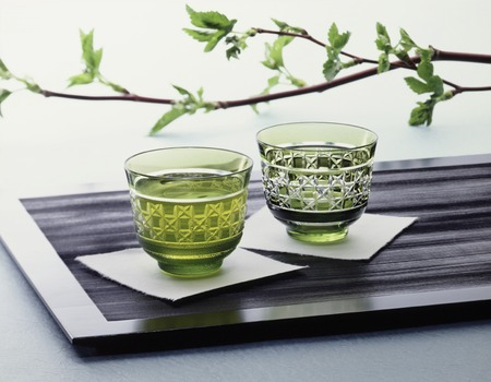 longitudinal: Longitudinal basin that was placed the shoots of twigs to iced tea glass Stock Photo