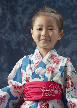 exhilaration: Girl bust laugh in yukata Stock Photo