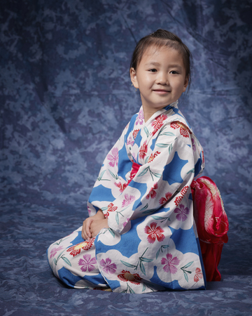 By sitting straight sideways view front yukata girl